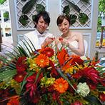 アプロディールハート:装花もケーキも南国をテーマにふたりらしさをアピール。ゲストに感謝を伝えるサプライズ演出が喜ばれた