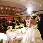 福山ニューキャッスルホテル:プランナーの采配でピアノと映像を使った大掛かりな余興が実現。シェフのフランベショーもゲストに大好評!