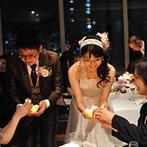 神戸ベイシェラトン ホテル&タワーズ:ホテルの最上階にある上質なレストランでのパーティ。幻想的なキャンドルリレーで記憶に残る幸せな時間に