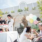 星ヶ丘・アートグレイスクラブ:ガーデン付きの貸切邸宅で、アットホームなパーティ。青空の下でのケーキカットは、とびきり爽やか!