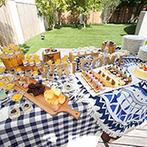 EXEX SQUARE (エグゼクス・スクエア):ひまわりや青いケーキで夏を演出。ガーデンでのデザートビュッフェにはそうめんを加えてゲストをおもてなし
