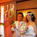 ロワジールホテル 豊橋:眺望のよい会場を、和と洋が映えるカラーや装花でコーディネート。お寿司をプラスした料理もボリューム満点