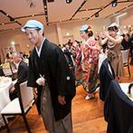 ガーデンテラス長崎 ホテル&リゾート:両家の親たちにファーストバイトのサプライズ演出も。余興を多く取り入れ、笑い声がたくさん響いたパーティ
