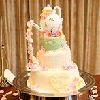 アルコラッジョ(arcoraggio):オリジナルケーキが話題をさらった!キュートな空間で楽しんだ「ティーパーティ」がテーマの披露宴