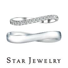 スタージュエリー_《スタージュエリー》ダイヤモンドが薬指に沿って輝くウェイブのエタニティリング