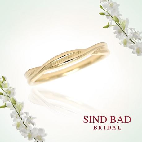SIND BAD:クロスタイプの結婚指輪 ダイヤ5石がグラデーションのよう