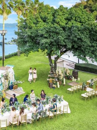 シーサイド平川MASARU リゾート感溢れるガーデンウエディング画像1-2