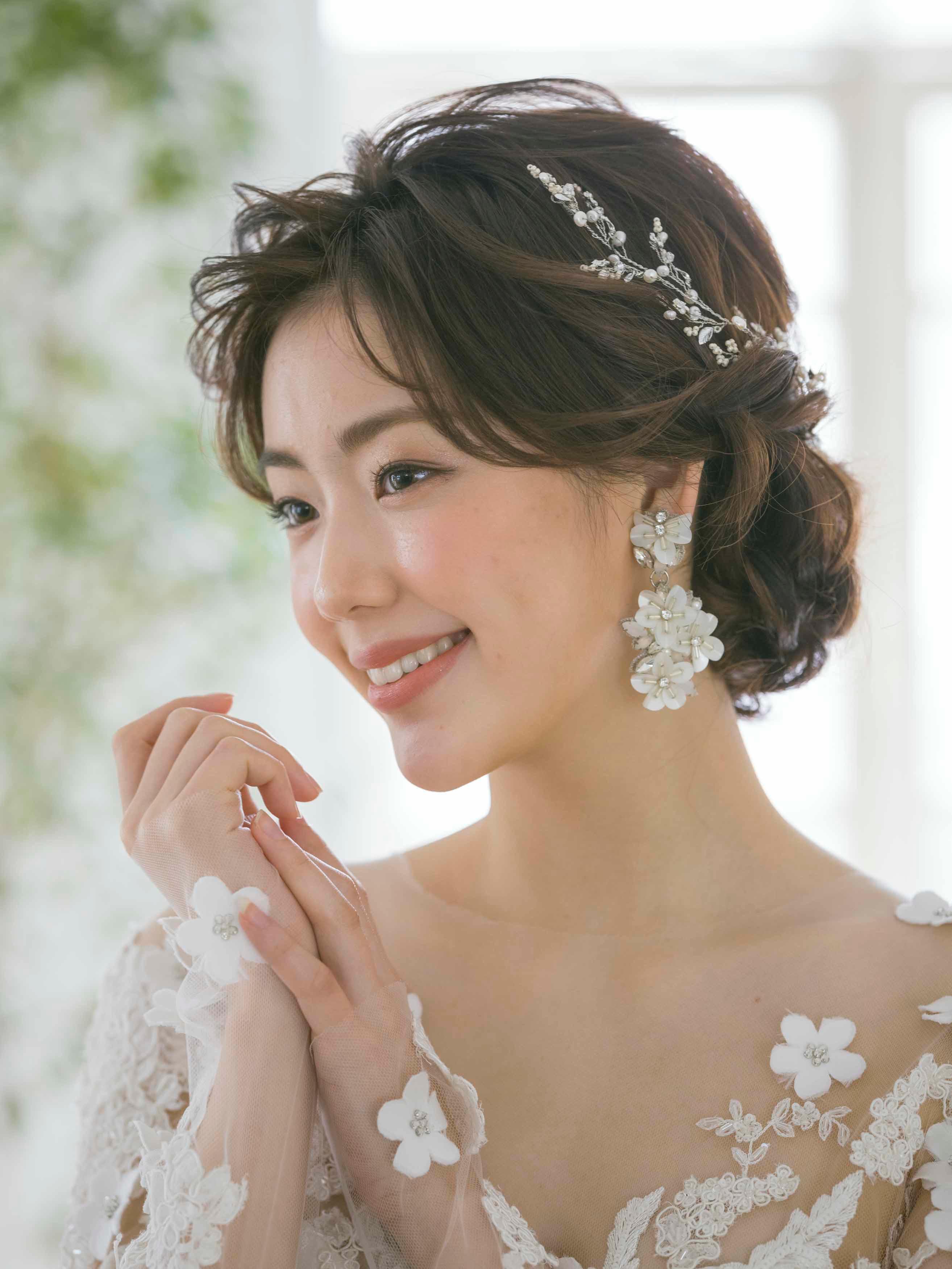 ウエディングドレス 髪型 ローシニヨン