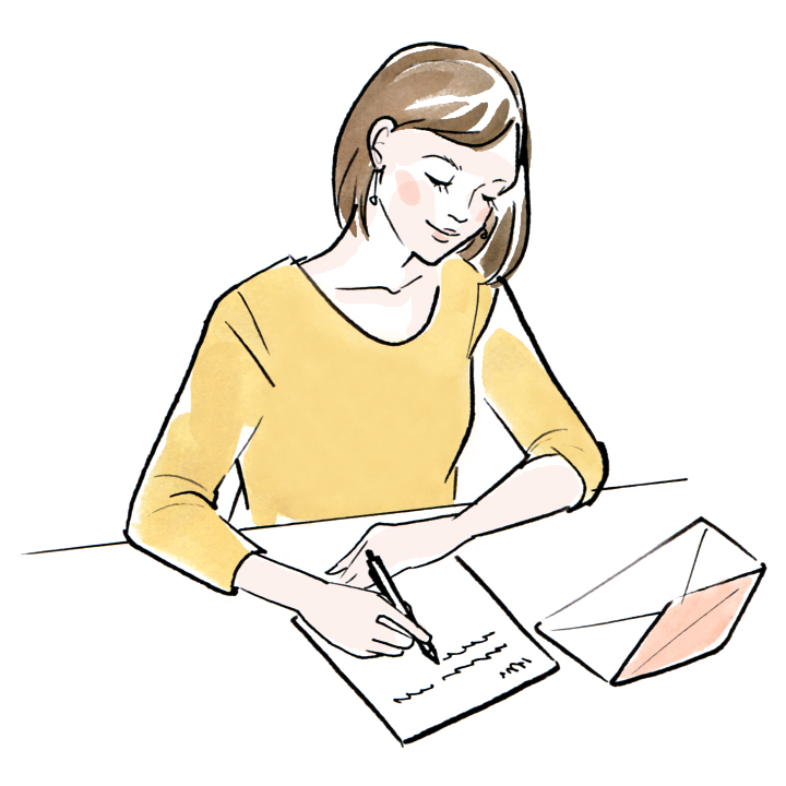 手紙書く女性