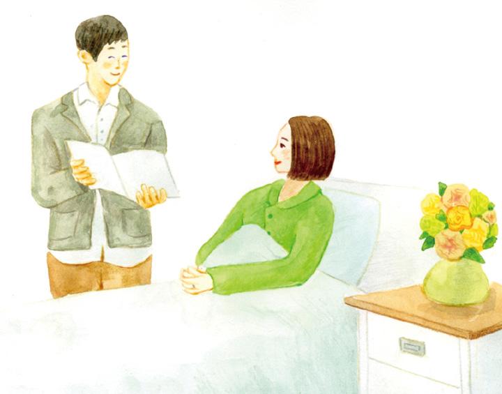 入院中の女性とその夫