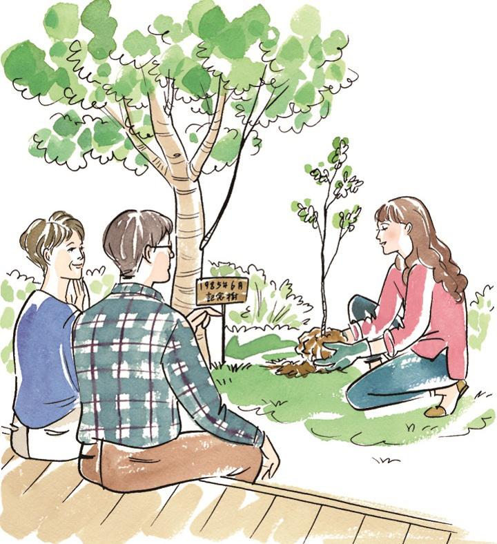 実家に記念の植樹をする女性