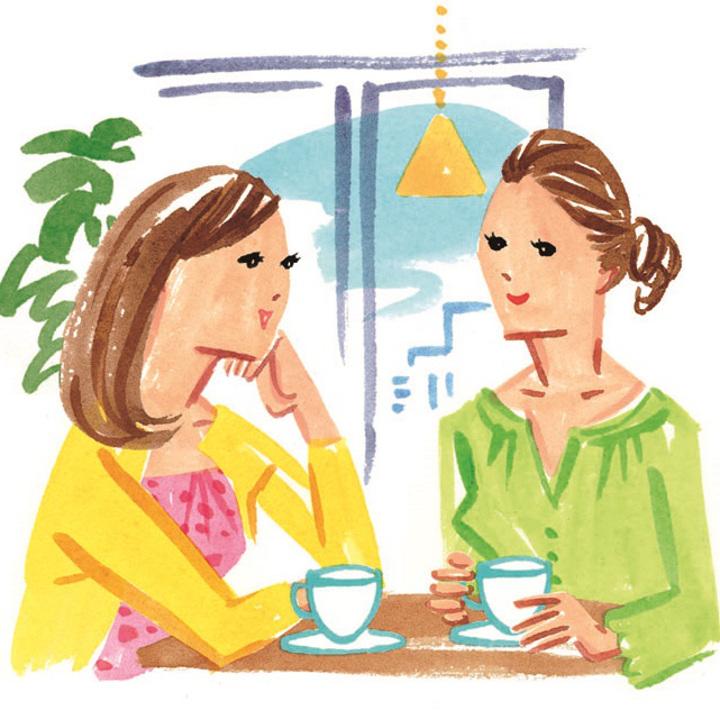 親友とお茶を飲みながらおしゃべりする女性