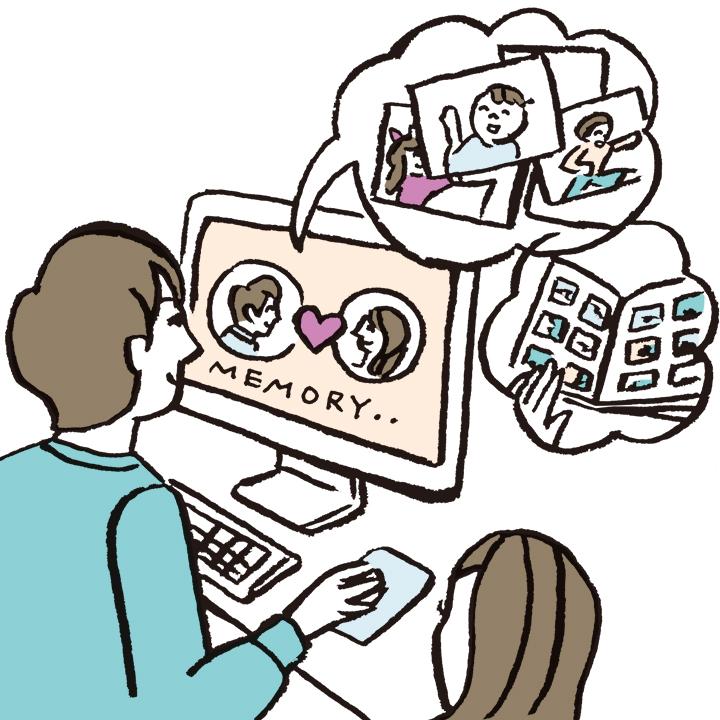 演出用のムービーをパソコンで制作しているカップル