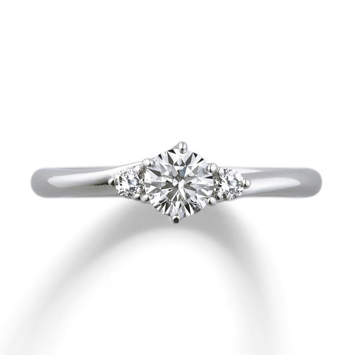 センターダイヤの両脇にメレダイヤを2石あしらったエレガントなリング