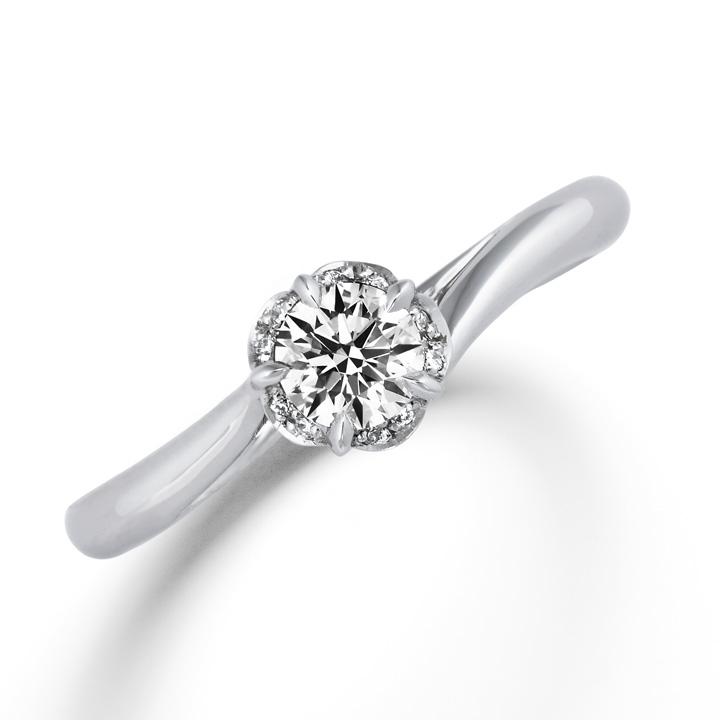 センターダイヤモンドの周りに10石のメレダイヤをあしらった婚約指輪