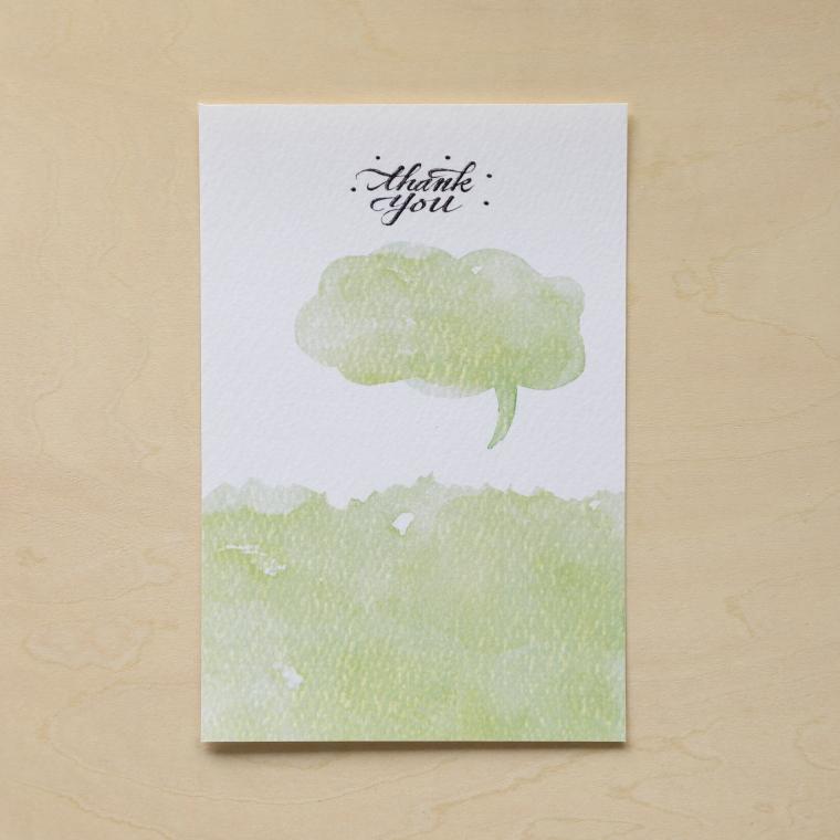 デザインを印刷したはがきサイズの紙