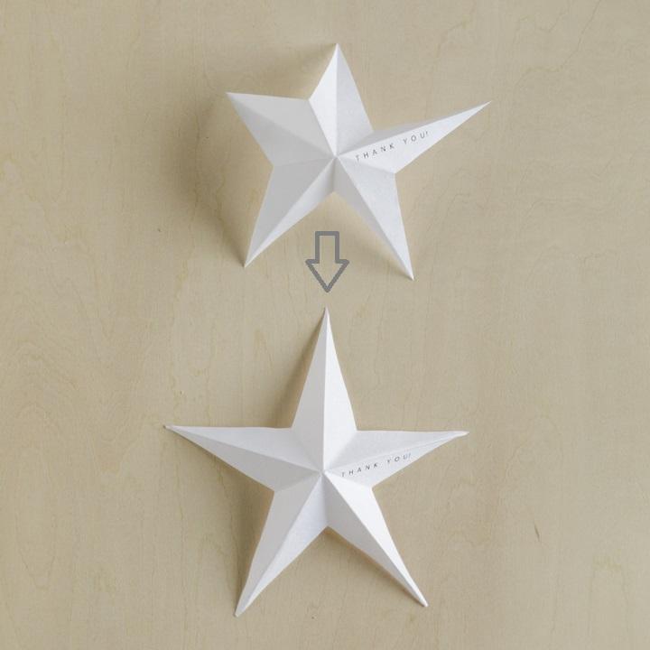 折り目の凹凸をそろえて星形を整えている様子